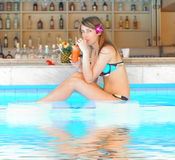 Girl in tropical pool bar Stock Image