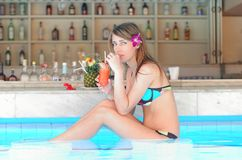 Girl in tropical pool bar Royalty Free Stock Photos