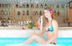 Girl in tropical pool bar Stock Photos
