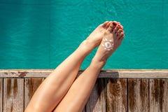 Girl at tropical swimming pool Royalty Free Stock Photos