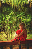 Girl in the tropics sits and dreams Royalty Free Stock Photography