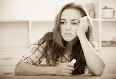 Girl in trouble with handkerchief Royalty Free Stock Images