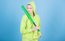 Girl troublemaker. Woman play baseball game or going to beat someone. Girl hooded jacket hold baseball bat blue. Background. Woman in baseball sport. Baseball royalty free stock images