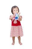 Girl with trumpet toy Stock Images