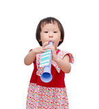 Girl with trumpet toy Royalty Free Stock Images