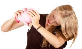 Girl try to take money from piggy bank Stock Photos