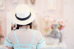 Girl trying dress is looking in mirror Royalty Free Stock Image