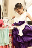 Girl trying on elegant dress Royalty Free Stock Photos