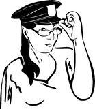 Girl trying on glasses in a police cap Royalty Free Stock Photography