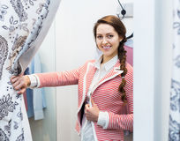 Girl trying on new blouse Royalty Free Stock Images