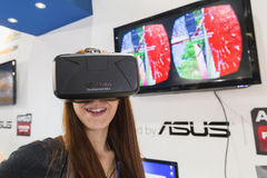 Girl trying Oculus headset at Games Week 2014 in Milan, Italy Royalty Free Stock Photography