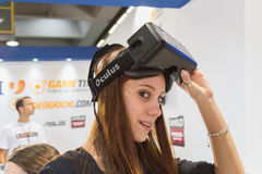 Girl trying Oculus headset at Games Week 2014 in Milan, Italy Stock Photos