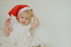 Girl trying red santa head Royalty Free Stock Photo
