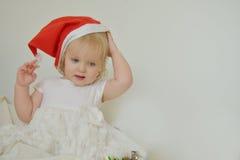 Girl trying red santa head Royalty Free Stock Photo