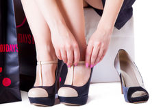 Girl trying  shoes Stock Image