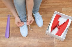 A girl trying on sneakers royalty free stock photography