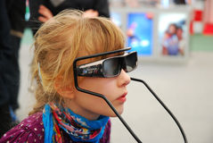 Girl trying SONY 3D glasses. LODZ-16,04,2011 FOTO-VIDEO FAIR. Girl trying SONY 3D glasses for new technology television and games Stock Photos