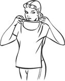 Girl trying t-shirt. Girl checking out t-shirt Royalty Free Stock Photography