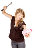 Girl trying to break piggy bank. Young woman trying to break piggy bank, white background Royalty Free Stock Images