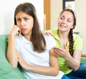 Girl trying to cheer up depressed friend Stock Photography