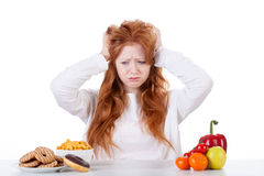 Girl trying to decide what to eat Royalty Free Stock Photography