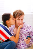 Girl trying to distract her boyfriend from mobile Stock Images