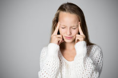 Girl trying to focus Stock Image