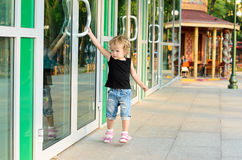 Girl trying to open the doors Royalty Free Stock Photo