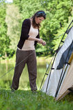 Girl trying to pitch a tent Stock Photos