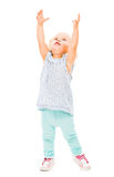 Girl trying to reach for somthing Stock Images