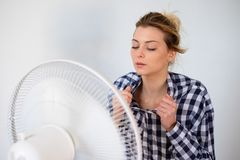 Girl trying to refresh from the summer heat haze Stock Images