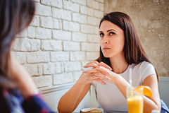Girl trying to remember something at the cafe. Girl with thinking expression trying to remember something at the cafe Stock Photo