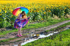 Girl trying to walk over mud puddle Stock Image