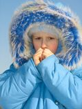 Girl trying to warm fingers Stock Photos