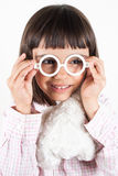 Girl trying toy glasses Royalty Free Stock Photography