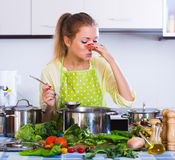 Girl trying unpatable meal Stock Photos