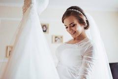 Girl trying on wedding dress Stock Image