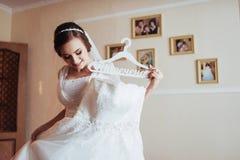 Girl trying on wedding dress Stock Photos