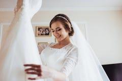 Girl trying on wedding dress Royalty Free Stock Photo