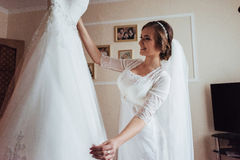 Girl trying on wedding dress Royalty Free Stock Images