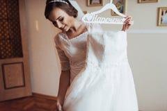 Girl trying on wedding dress Royalty Free Stock Photos
