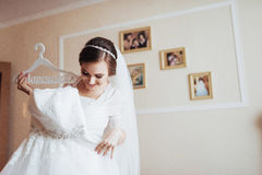 Girl trying on wedding dress Stock Images