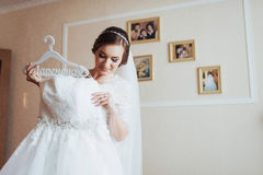 Girl trying on wedding dress Royalty Free Stock Photography