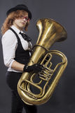 The girl with a tuba Royalty Free Stock Images