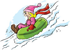 Girl tubing. Down a hill and having a great time Royalty Free Stock Images