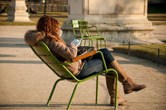 Girl in Tuileries garden in Paris Stock Photos