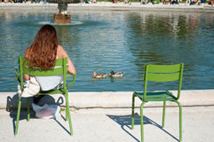 Girl in Tuileries garden in Paris stock images