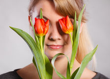 Girl with tulip feel connection to nature. Royalty Free Stock Image