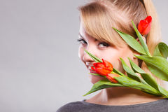 Girl with tulip feel connection to nature. Royalty Free Stock Photography