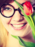 Girl with tulip feel connection to nature. Stock Photo